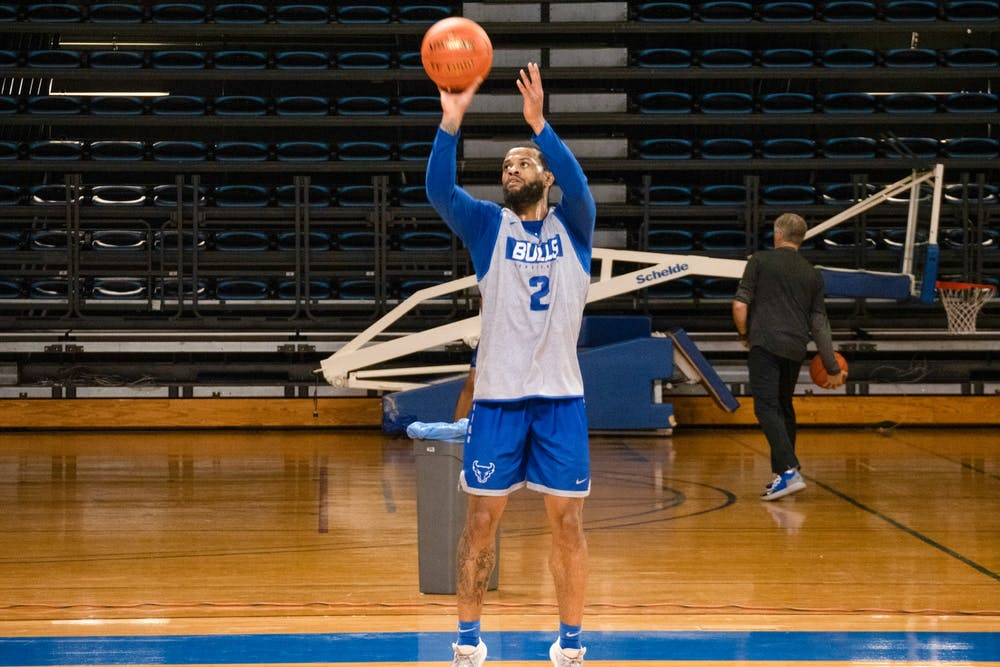 <p>Senior guard Antwain Johnson shoots a 3-pointer during practice at Alumni Arena. Johnson has scored 41 points for the Bulls this season.</p>