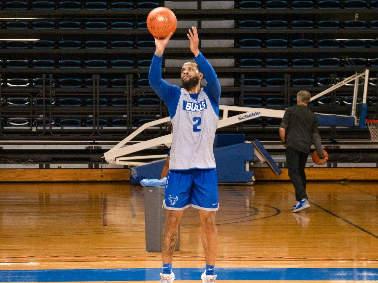 Senior guard Antwain Johnson shoots a 3-pointer during practice at Alumni Arena. Johnson has scored 41 points for the Bulls this season.