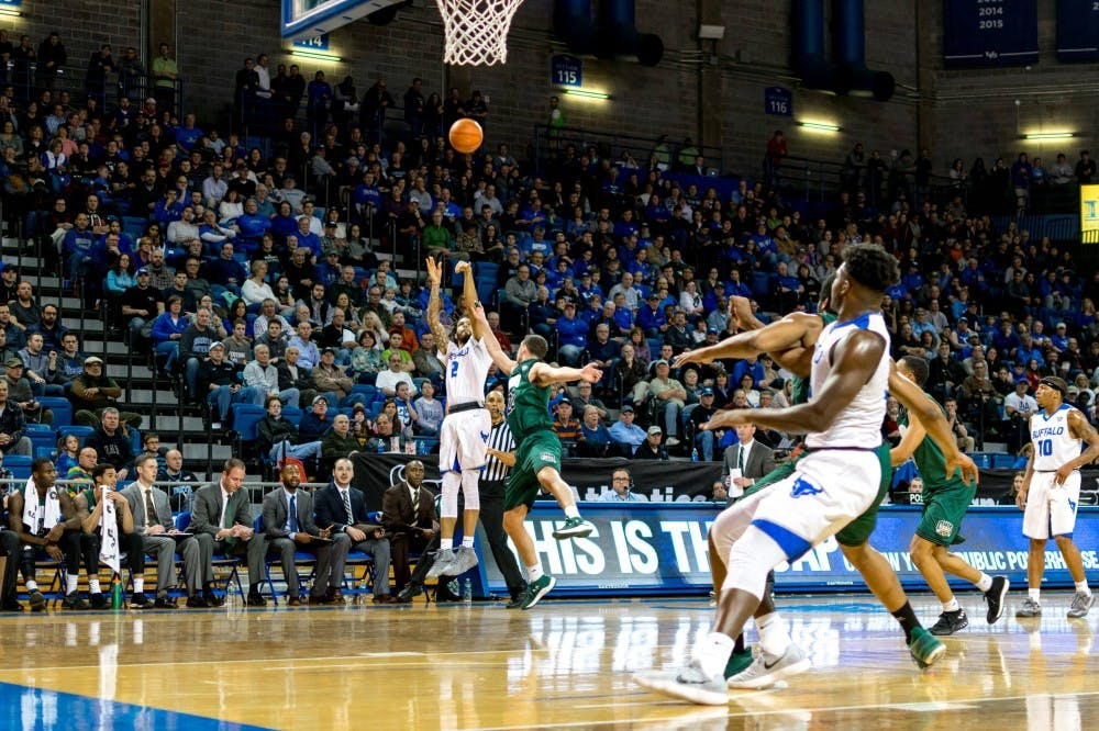 <p>Junior guard Jeremy Harris shoots from three-point range. Harris finished Saturday's contest with 12 points and 10 boards.&nbsp;</p>