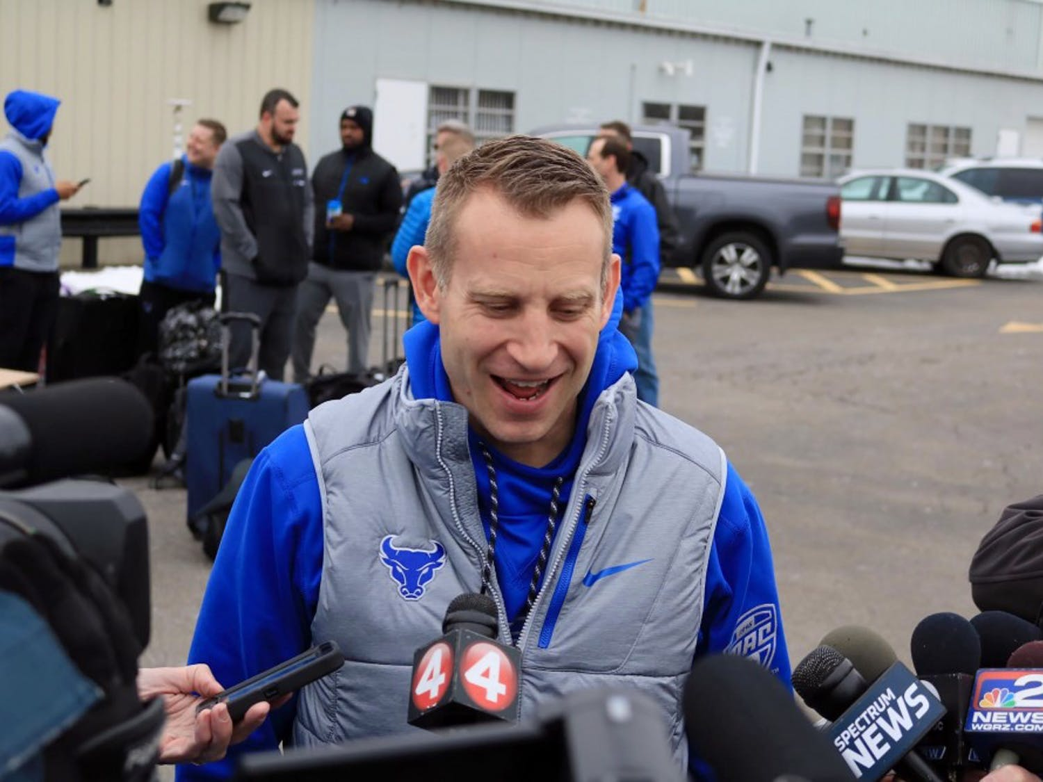 Bulls head coach Nate Oats (side) and junior guard CJ Massinburg (side) talk to the media outside Prior Aviation before the Bulls left for Boise, Idaho. The Bull will take on projected top-five pick Deandre Ayton and the Arizona Wildcats.