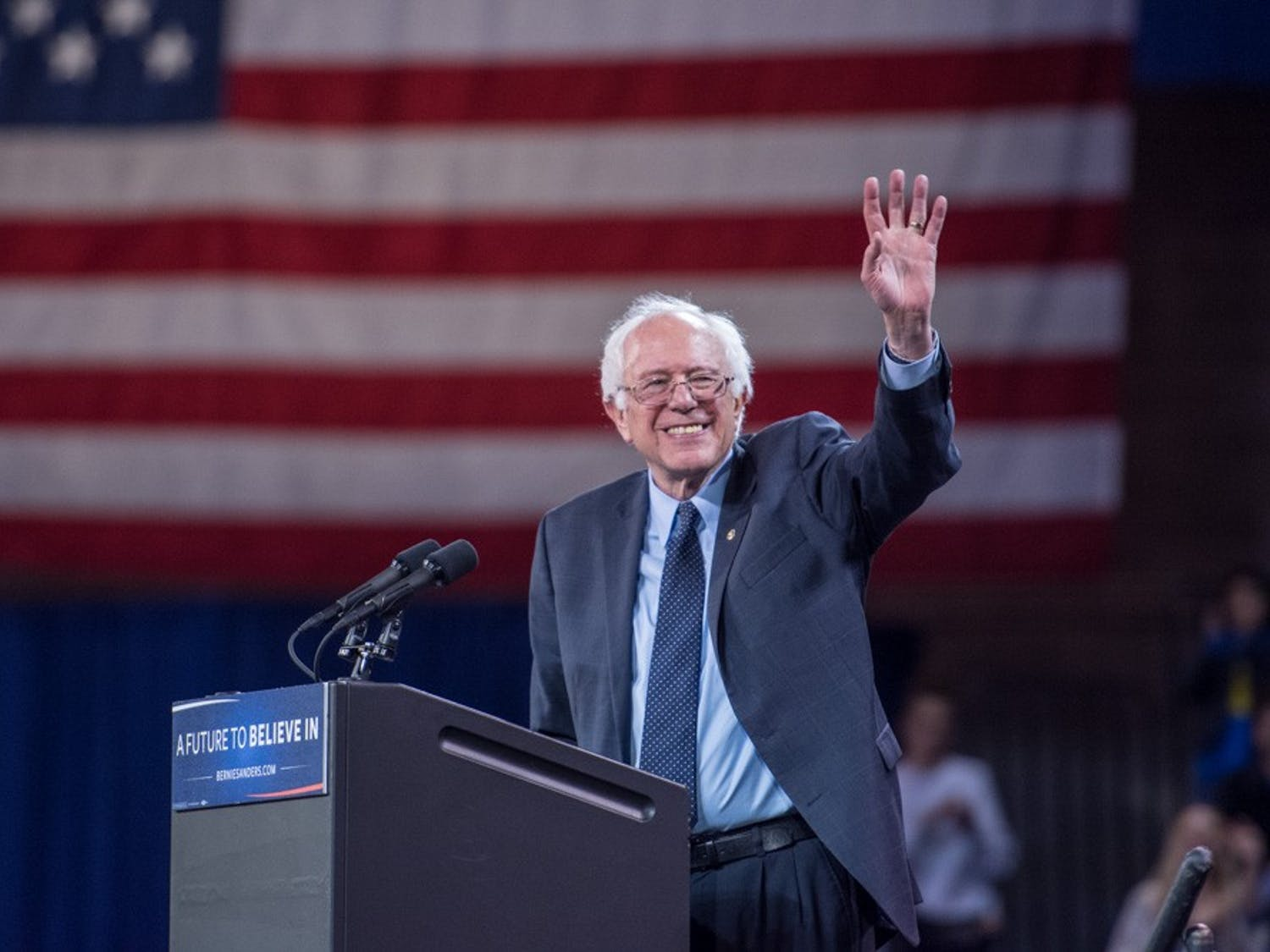 """Bernie Sanders waves to the crowd during his """"A Future to Believe in Rally"""" at Alumni Arena Monday evening."""