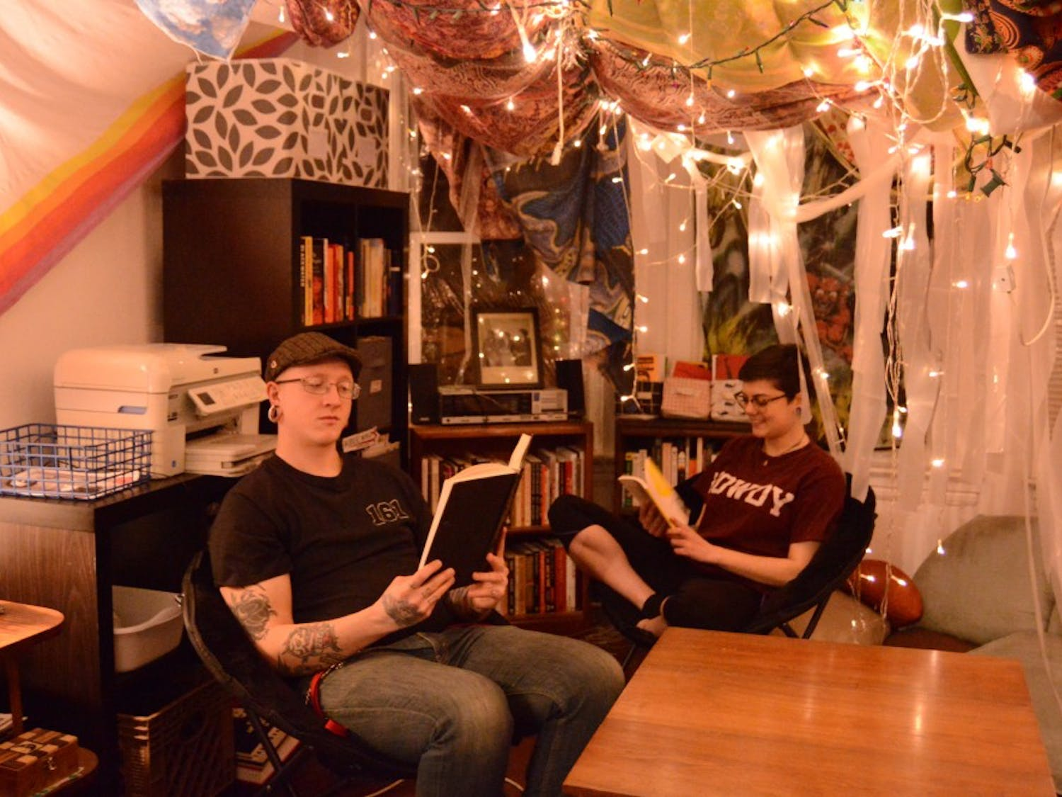 Residents of the Q3C Co-op sit in their community library. Co-ops offer an alternative housing option for many young people.