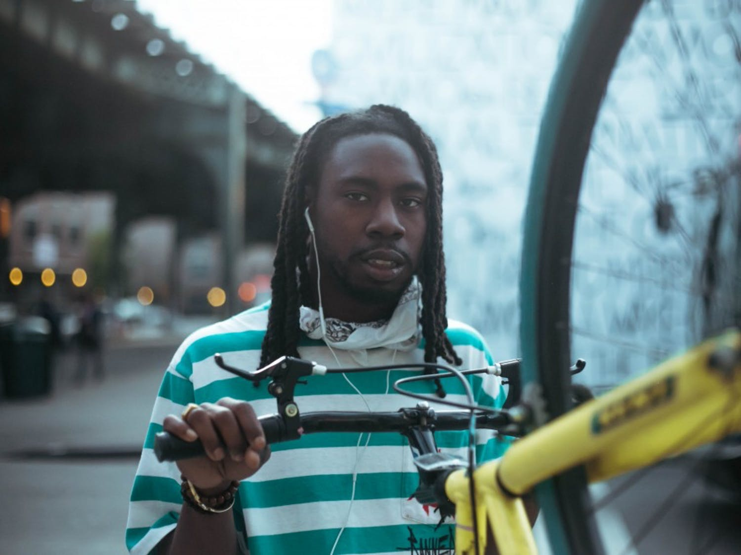 Buffalo rapper Billie Essco poses with a bicycle.