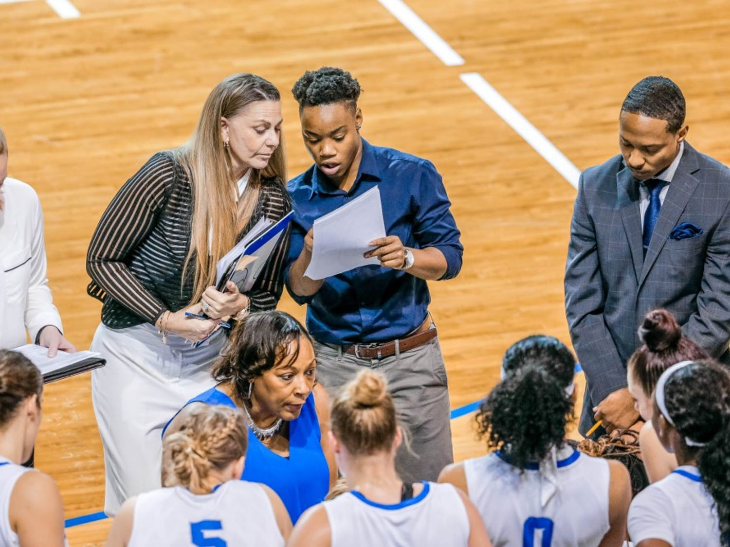 Director of Operations for the women's basketball team Karin Moss works with the team on the sideline. Moss was a member of the 2015-16 MAC Championship season and has now returned to the team for a new staff role.