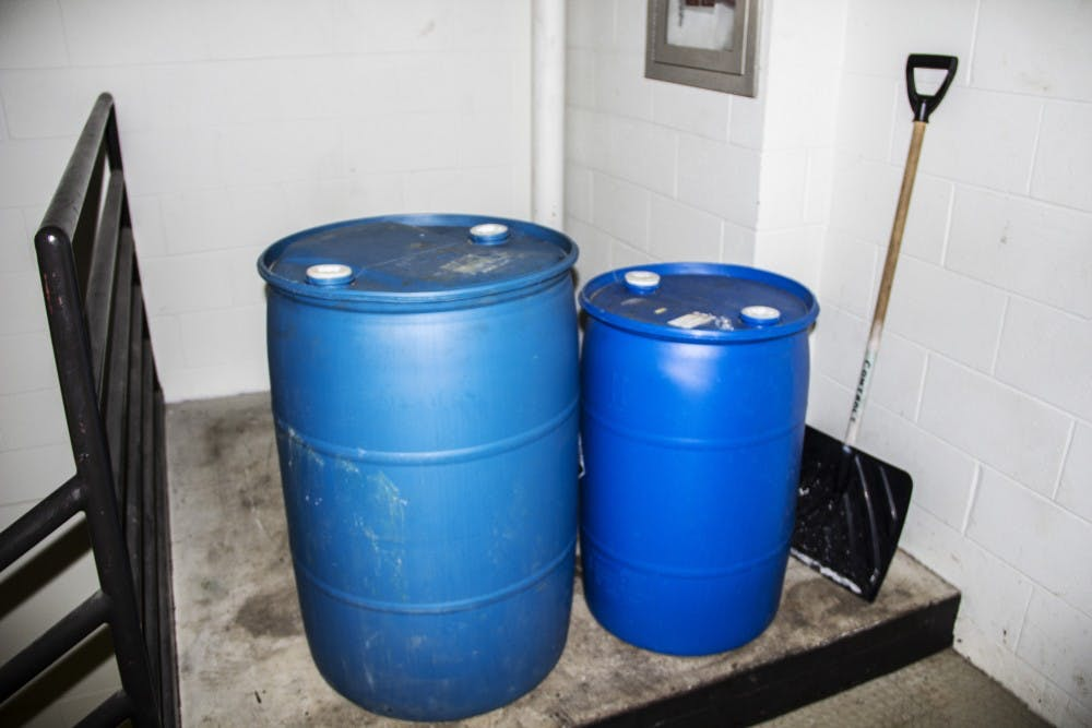 """<p><em>The Spectrum </em>found empty containers labeled """"corrosive"""" at the top of a stairwell in the Biomedical Education Building on Friday and Monday. UB had the containers moved by Tuesday morning following a <em>Spectrum </em>report.</p>"""
