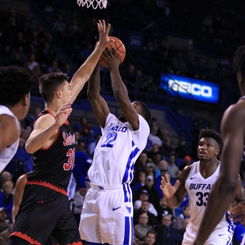 Men's basketball returns with a victory