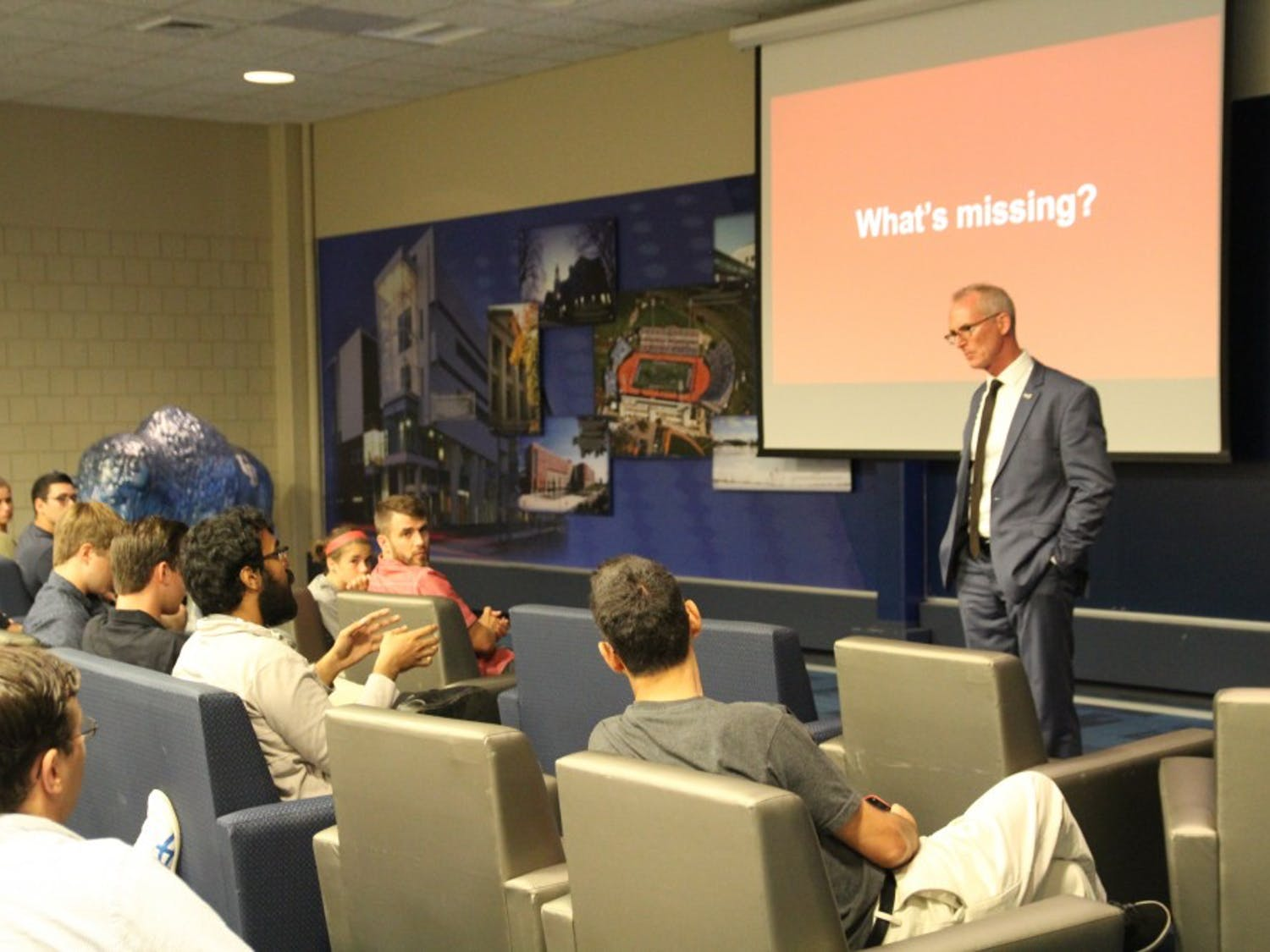 """Former U.S. Rep Bob Inglis (R-S.C.) speaks with students during an event in the Student Union on Thursday. Inglis proposed a free enterprise solution to climate change and talked about his """"metamorphosis"""" to understanding the issue as a conservative."""