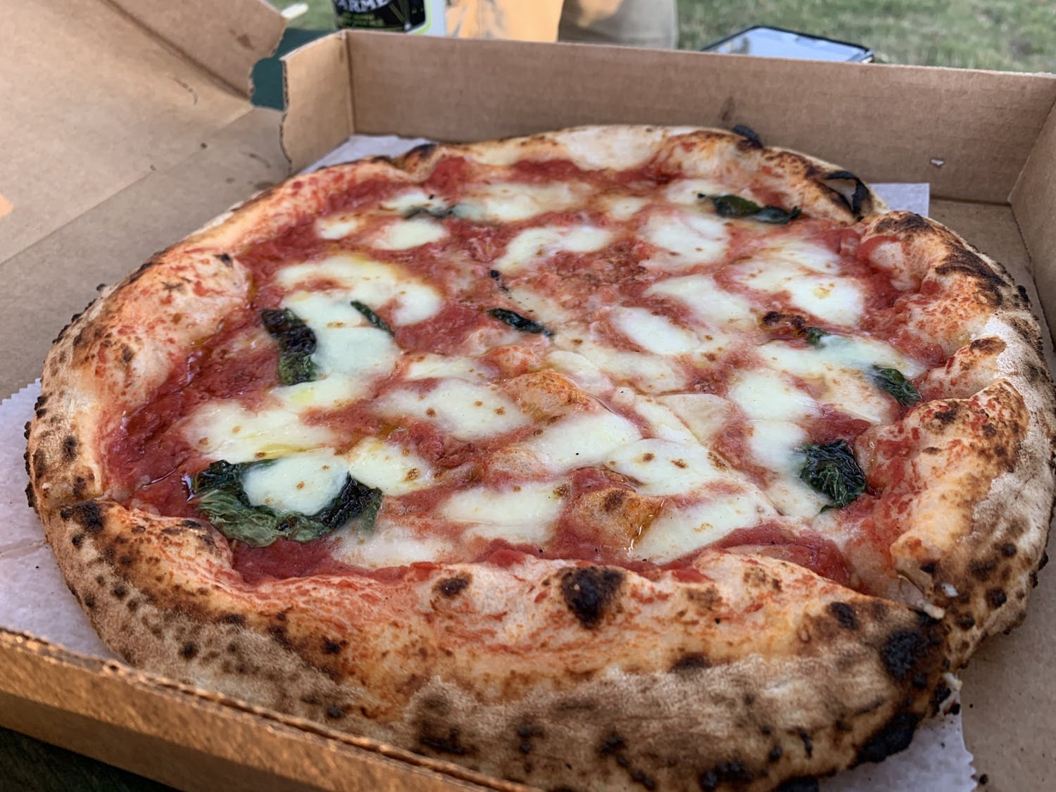Puffy and fresh, this Margherita pizza is hard to put down.