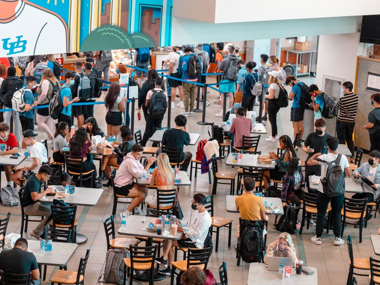 Students grab food, chat with friends and do work at the Student Union this fall.