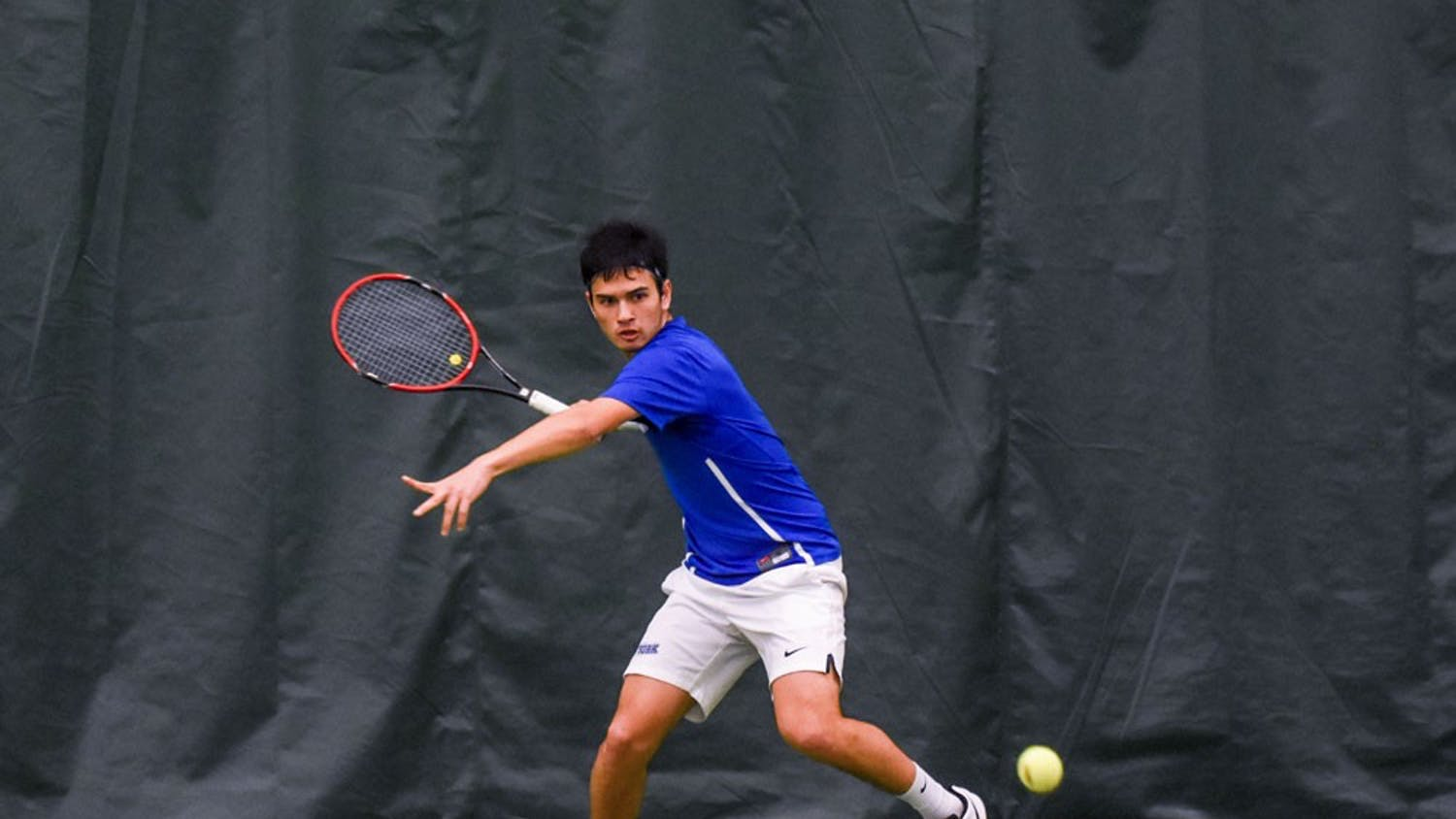 Senior Pablo Alvarez gets ready to return a ball during a match at the Miller Tennis Center. The men's tennis team is preparing for its regular season finale before the MAC Tournament.