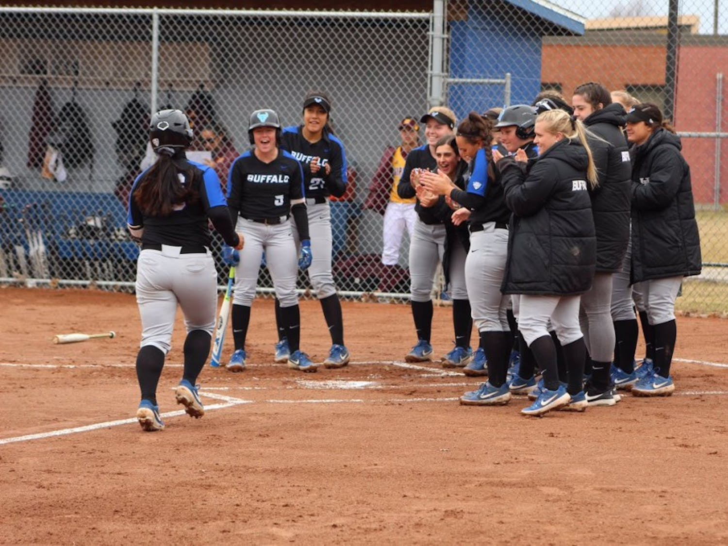 Sophomore left fielder Anna Aguon trots toward home after a home run. Aguon went 3-5 with two RBIs during the Bulls' 16-6 win against Akron.