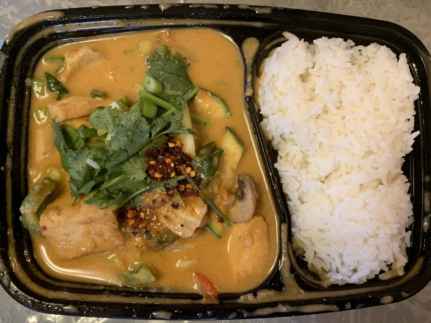 Diced tofu, mixed veggies and a pillow of white rice make a great meatless curry.