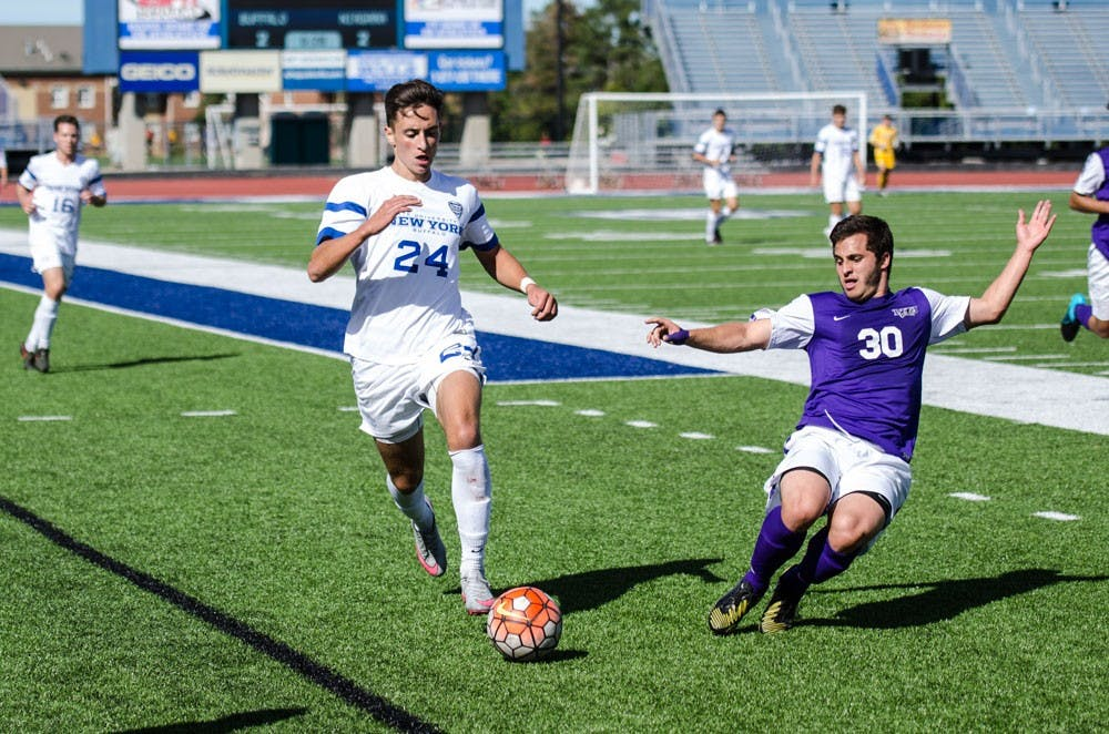 <p>Senior midfielder Brandon Scales dribbles past a Niagara defender last season. The Bulls will play Niagara University Thursday night seeking their seventh consecutive victory to open the season.</p>