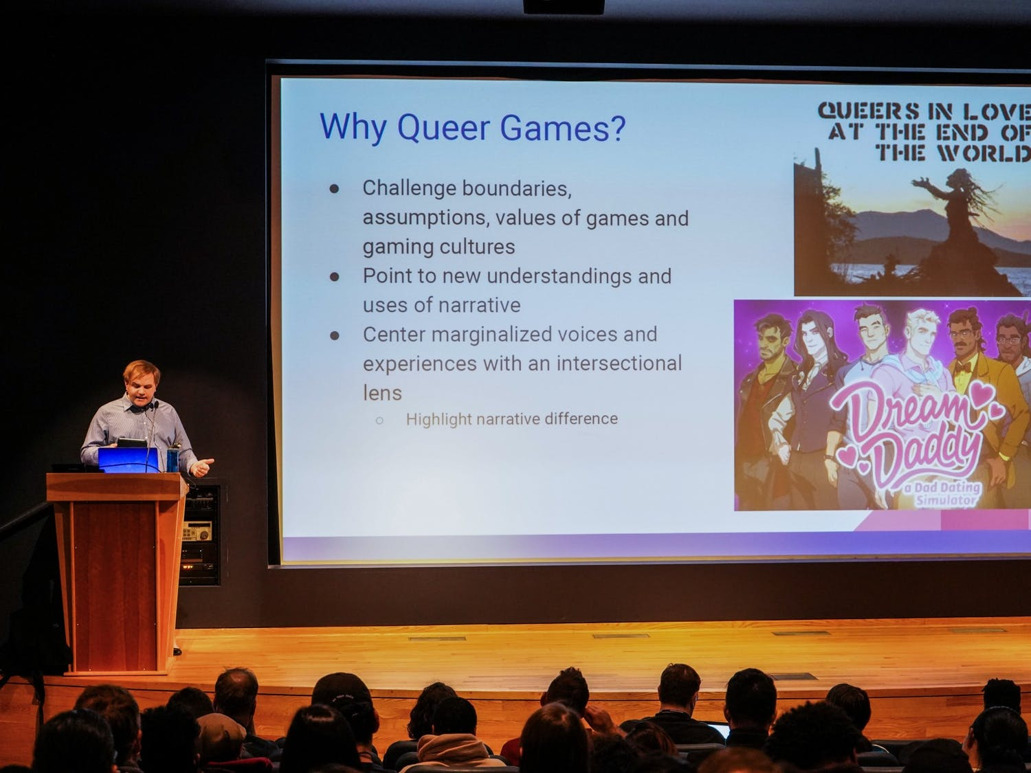 Assistant professor Cody Mejeur, Ph.D. lectures students on narrative video games involving the topics of gender and queer narrative to UB students Monday night at the Center for the Arts.