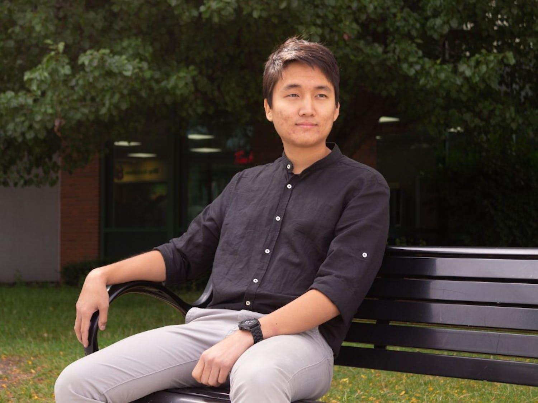 Portrait of Daeil Kim sitting outside the student union.