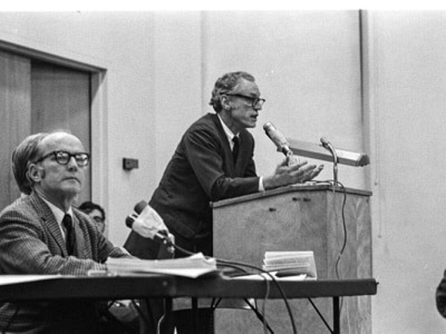 Peter Regan speaking at a faculty senate meeting in 1970.