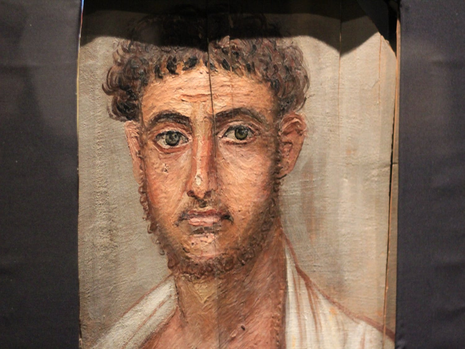 Greco-Roman style portraits emulated what the deceased looked like in their prime and were often displayed on the front of sarcophagi.