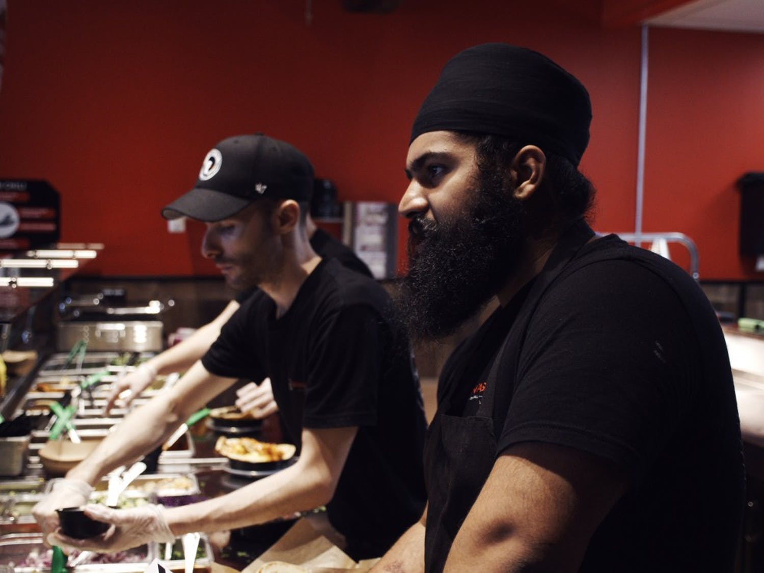 Naan-Tastic workers serving customers their unconventional Indian cuisine. The novel restaurant, which opened its doors on Friday, is owned and operated by UB alum, Aman Singh, and his brother, Ajay Singh.