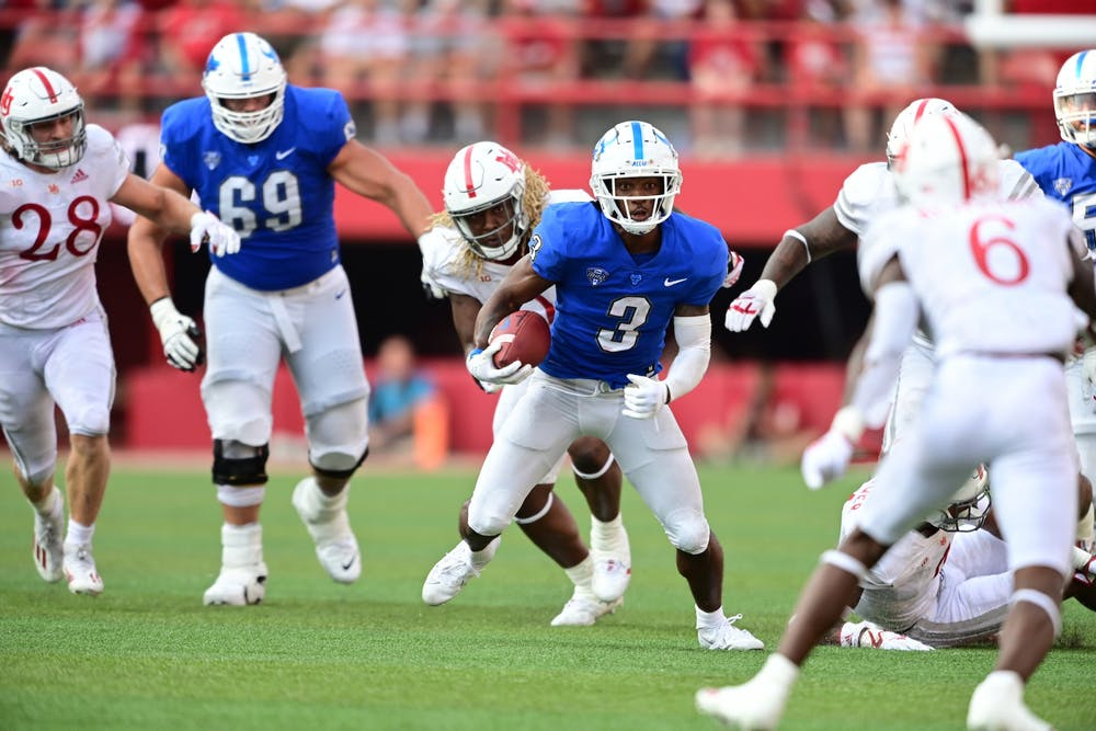 Senior wide receiver Quian Williams (3) evades tackles during UB's 28-3 loss to Nebraska Saturday.