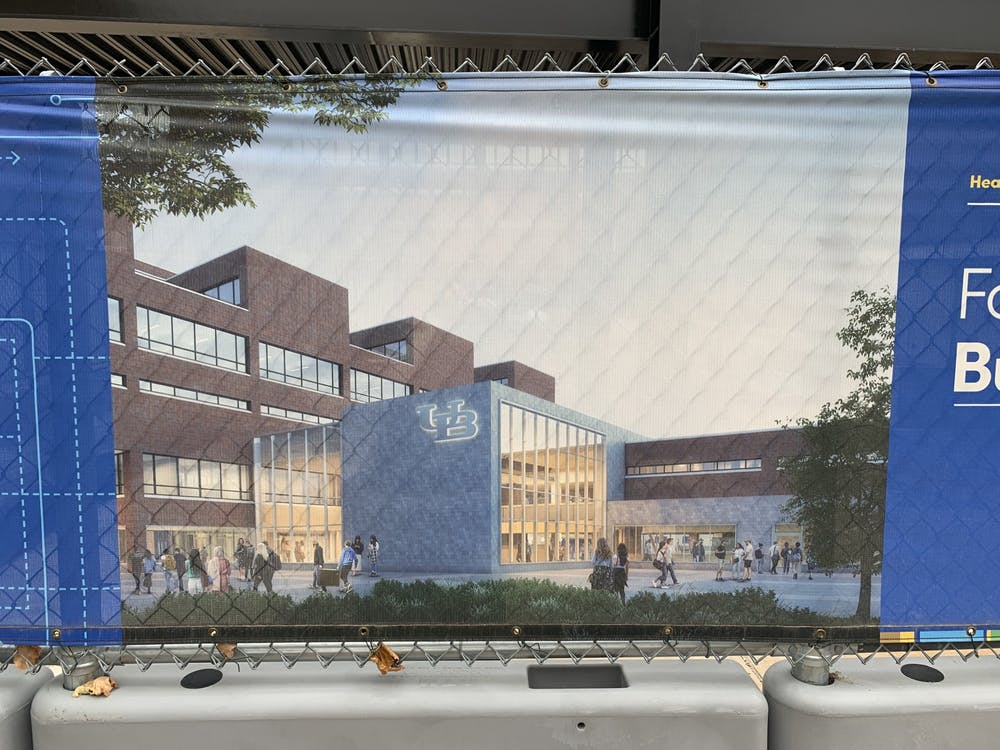One World Café, a three-story, 53,500-square-foot dining hall boasting international fare and community dining spaces designed for 800 visitors, will open in the spring.