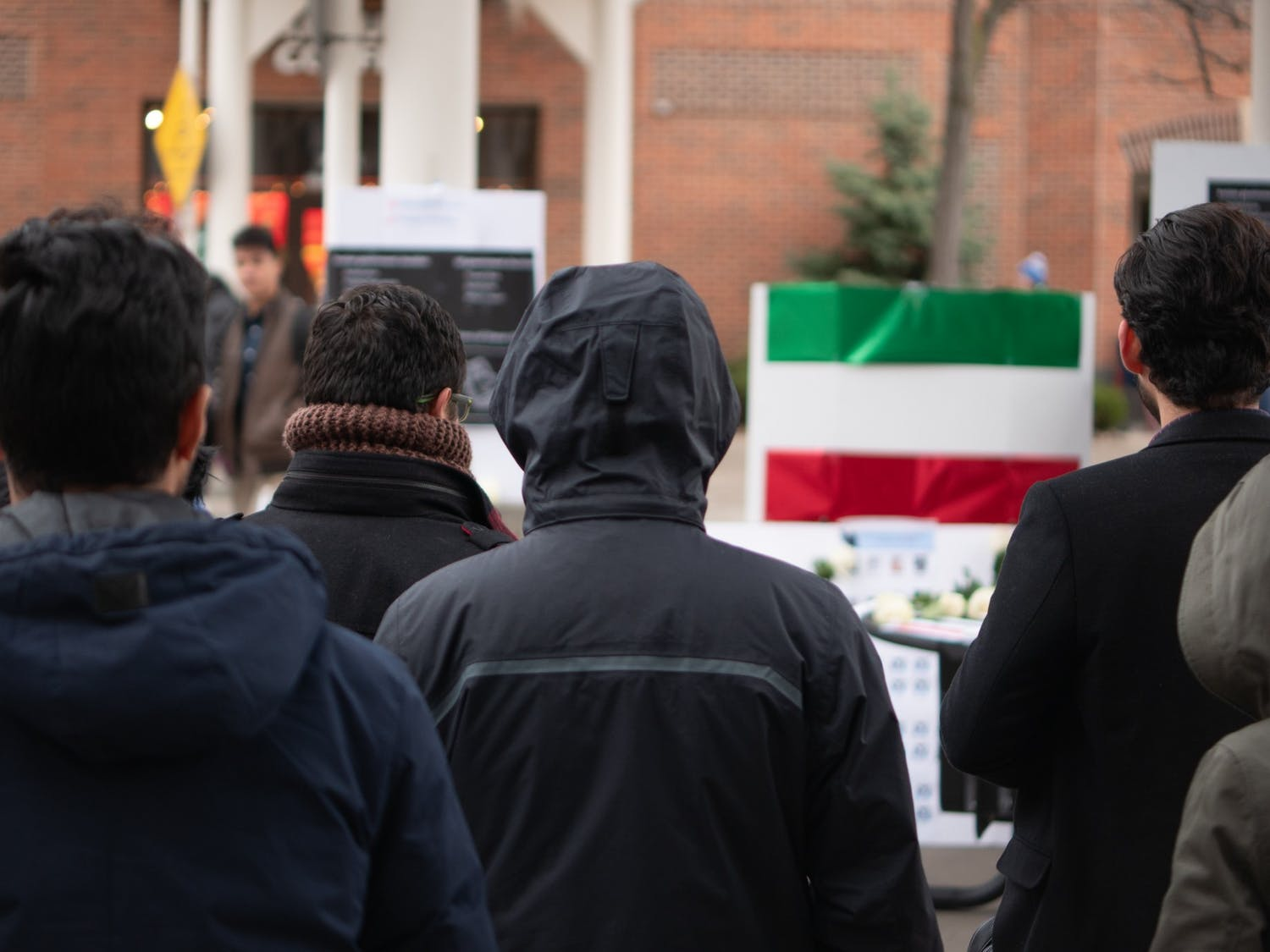 Iranian students and their supporters stand in solidarity outside Student Union on Thursday. The students brought light to the situation in Iran.