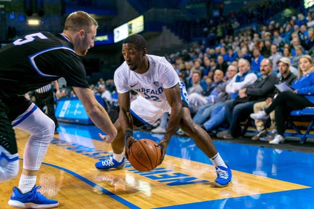 <p>Senior guard Dontay Caruthers picks up his dribble. Caruthers is a former MAC defensive player of the year and will be critical to the Bulls' defensive success this year.</p>