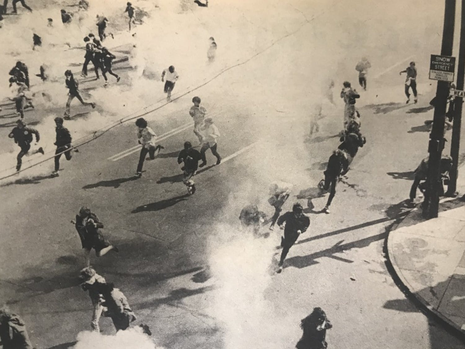 Students scatter from the South Campus when police released canisters of tear gas during an anti-Vietnam War demonstration.