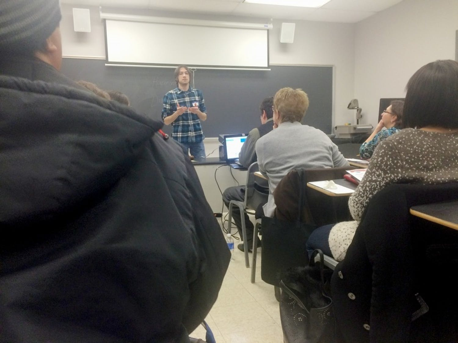 Aric Gaughan speaks about the effects of coffee in a speech at the UB Toastmasters meeting last week.