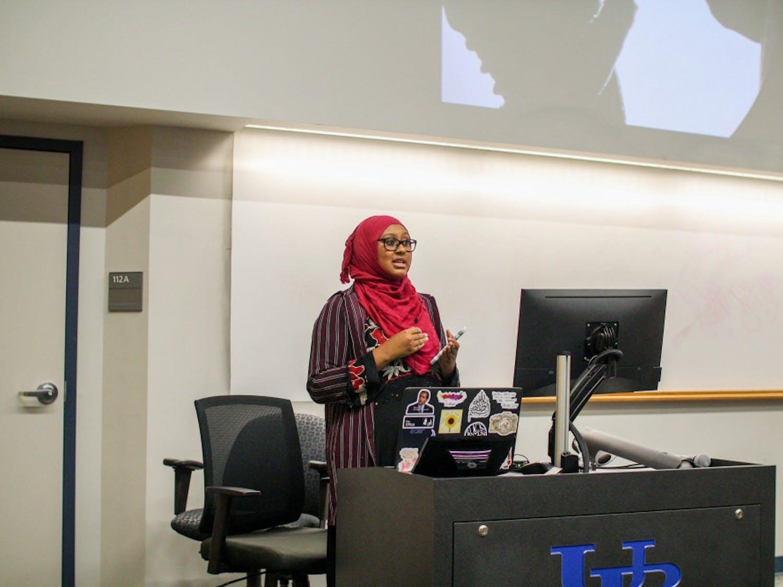 Muslim Student Association member Ilhan Noor introduces guest speaker April Arman.