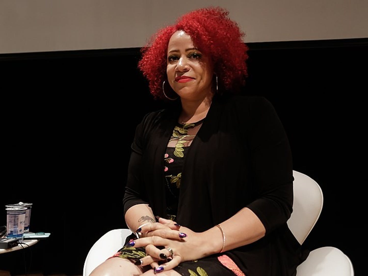 """Recognized as a MacArthur Genius and a Pulitzer-Prize winning journalist, Nikole Hannah-Jones is the creator of the New York Times' """"1619 Project,"""" which highlights the legacy of slavery."""