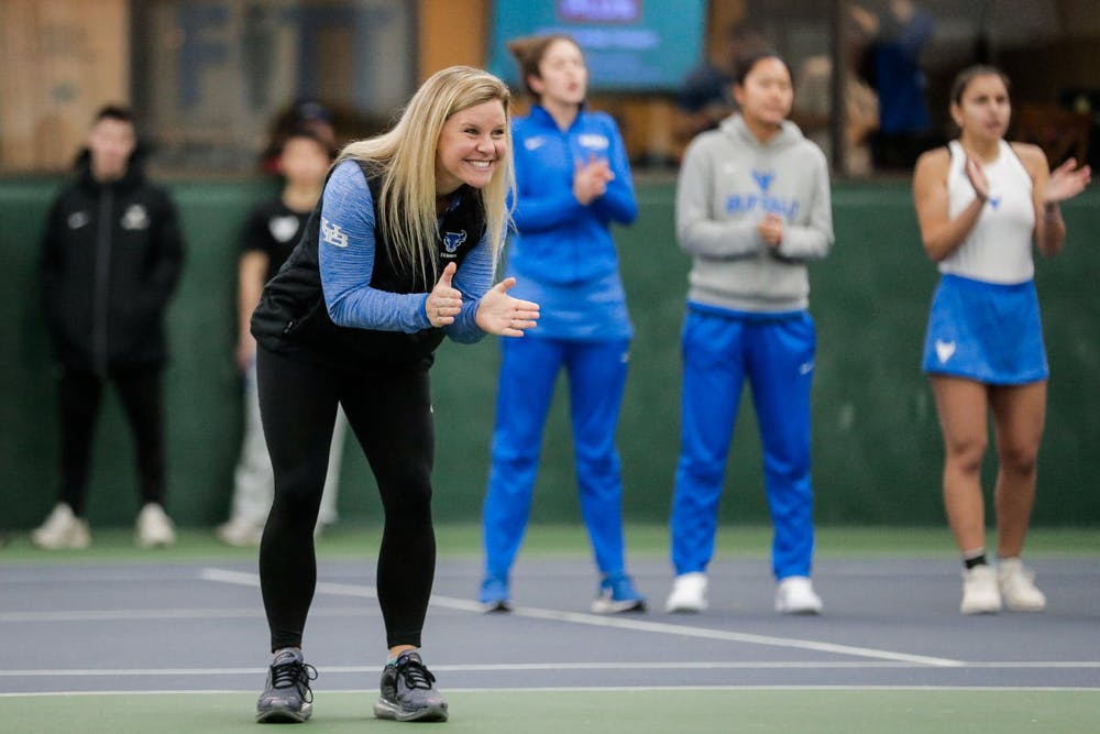 <p>Women's tennis coach Kristen Maines coaching her team.</p>