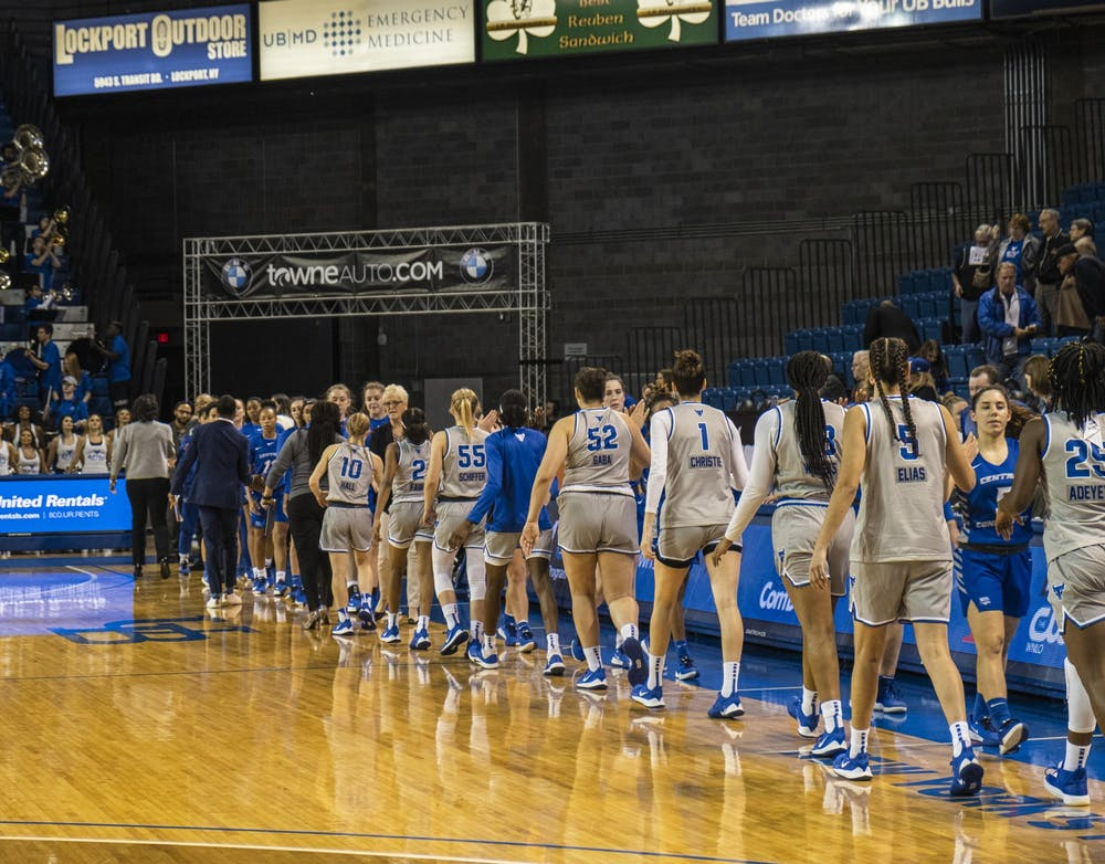 <p>The women's basketball team congratulates an opponent at the end of a game.</p>
