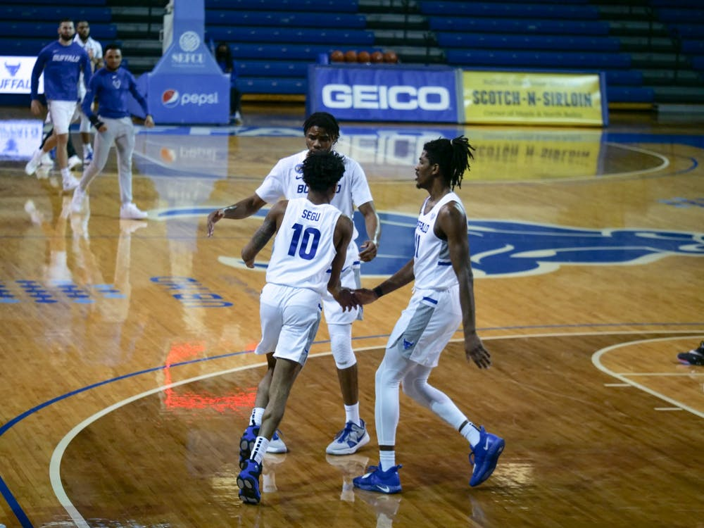 While Josh Mballa dominated inside, junior forward Jeenathan Williams and junior guard Ronaldo Segu (10) provided the Bulls with a considerable boost from three-point range.