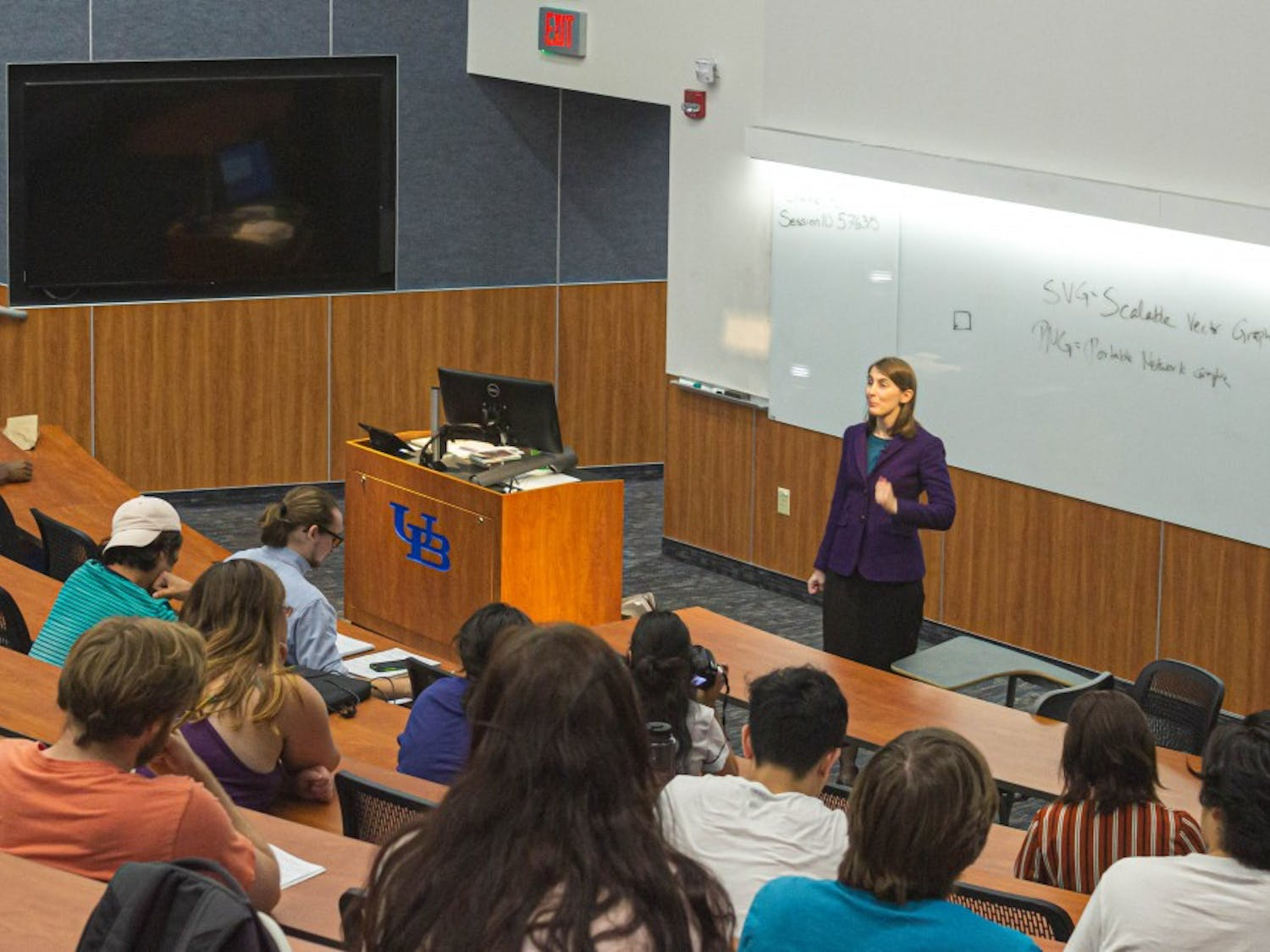"""Professor Amanda Kennell discusses """"Spirited Away"""" and """"Howl's Moving Castle"""" to her class of 119 undergraduates"""