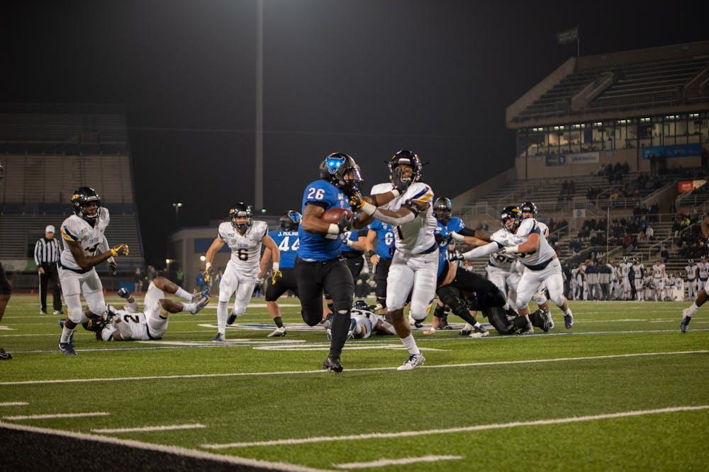 Running back Jaret Patterson holds a defender off him.