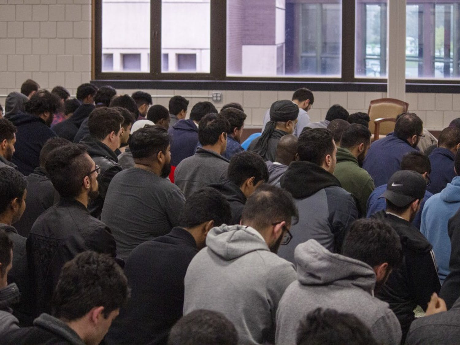 Male members of MSA pray during Friday's prayer call in the Student Union.