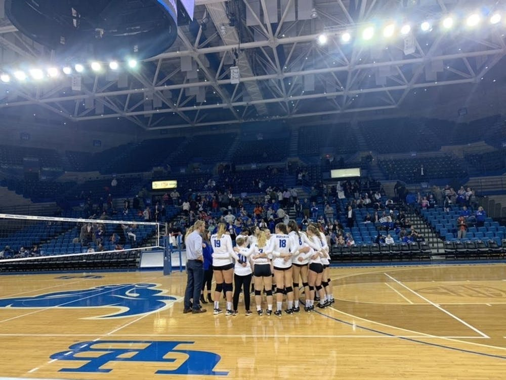 <p>Players stand in the middle of the court during volleyball's senior night Saturday.</p>