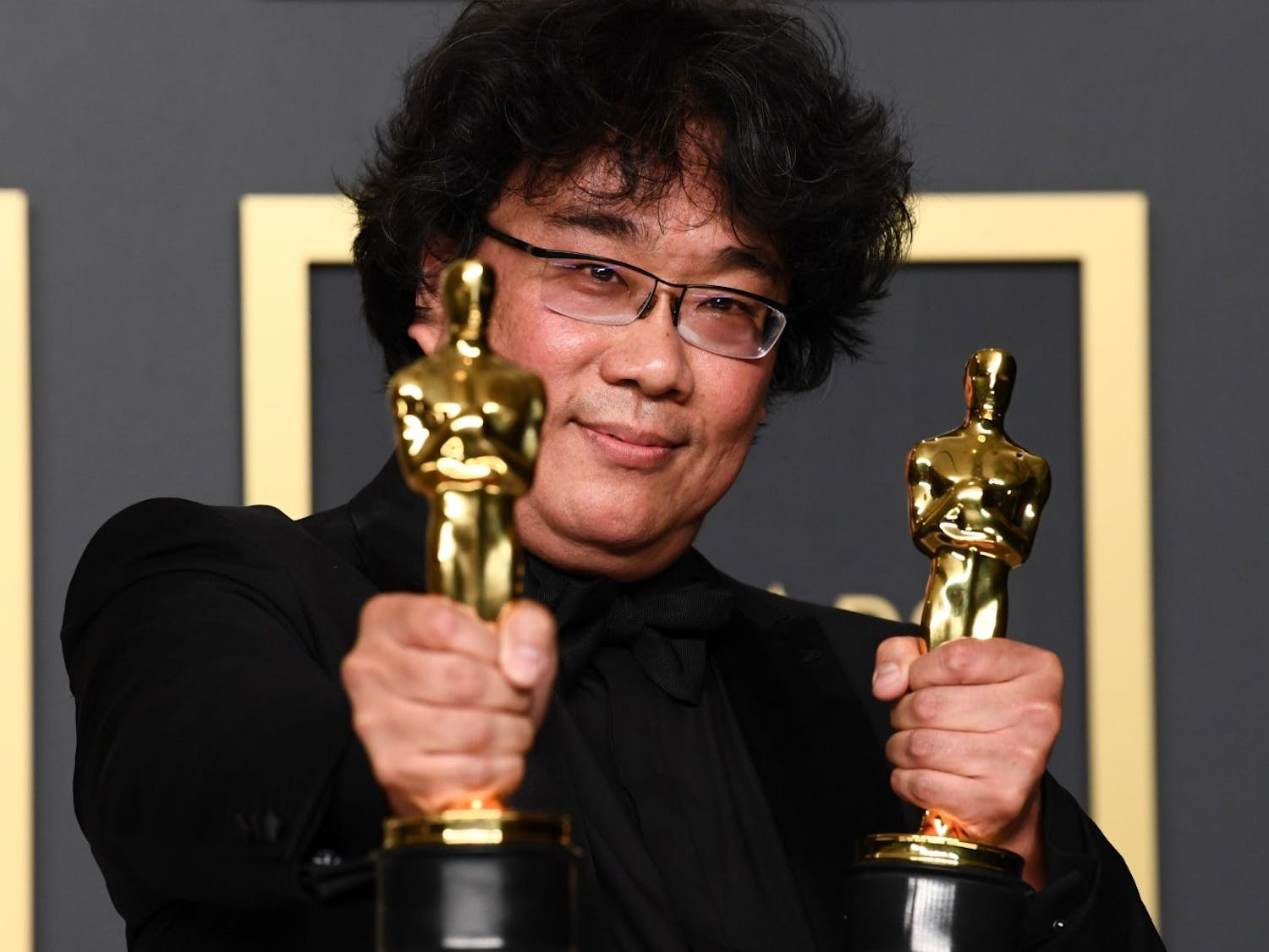 """Parasite"" director Bong Joon Ho holds two Oscars."
