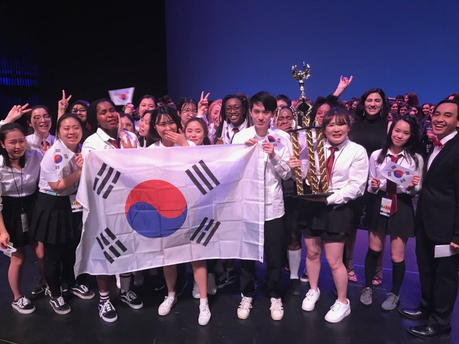 The Korean Student Association accepts the first place trophy at the 2019 International Fiesta.