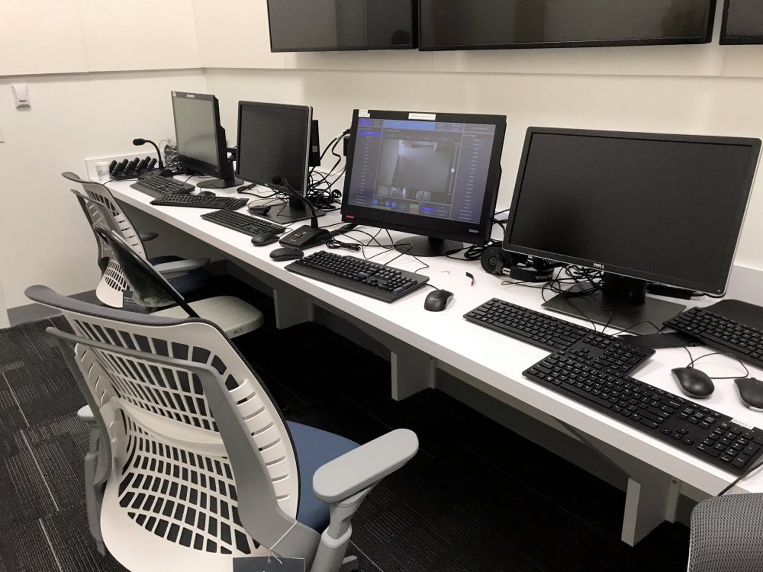 This control room has the capacity to digitally monitor and record the medical students working in exam and simulation rooms throughout the building.