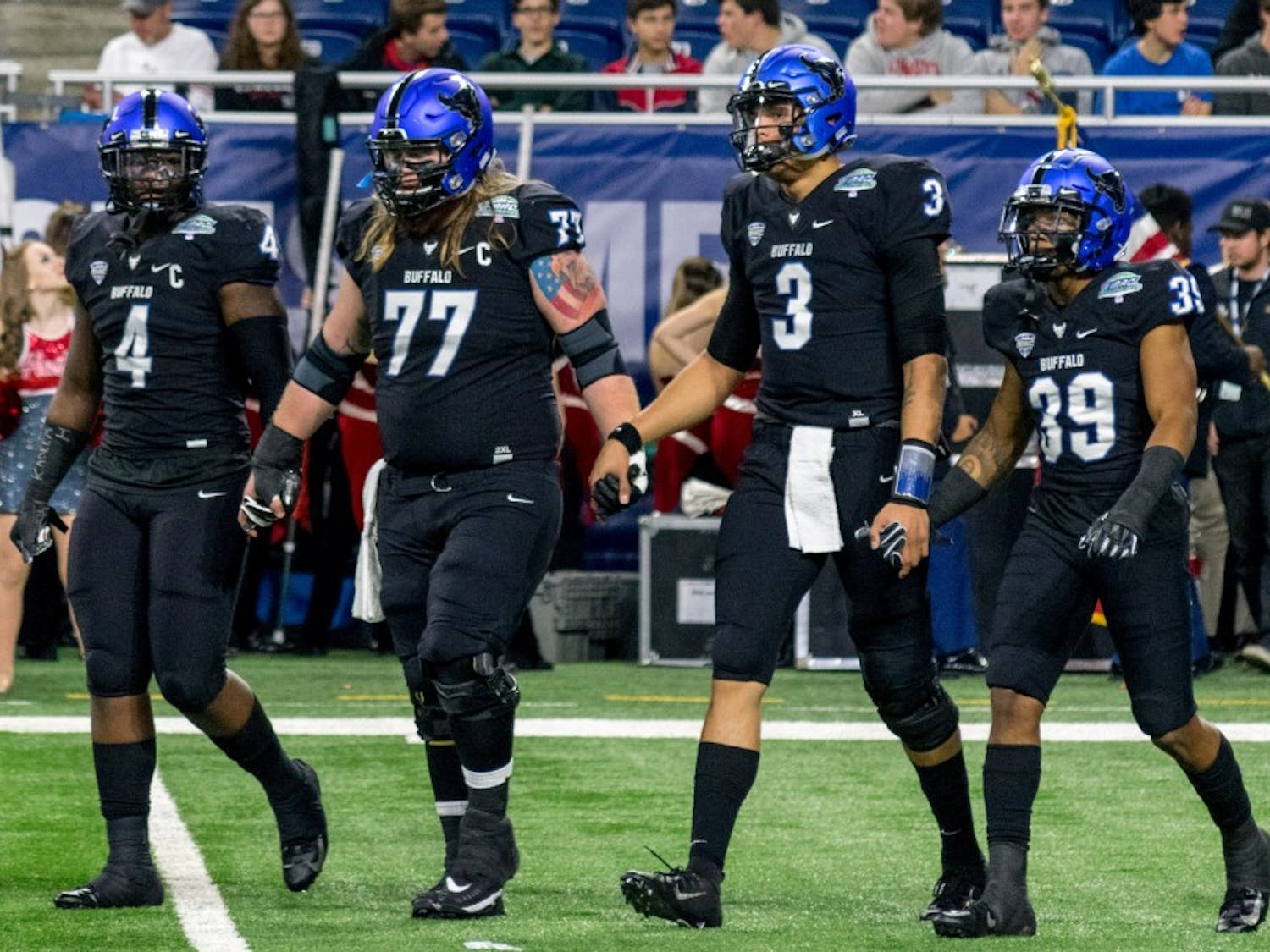 Captains of the UB football team including Tyree Jackson (3) and Cameron Lewis (39) walk onto the field at the MAC Championship game. Jackson and Lewis both became members of the Bills this weekend.