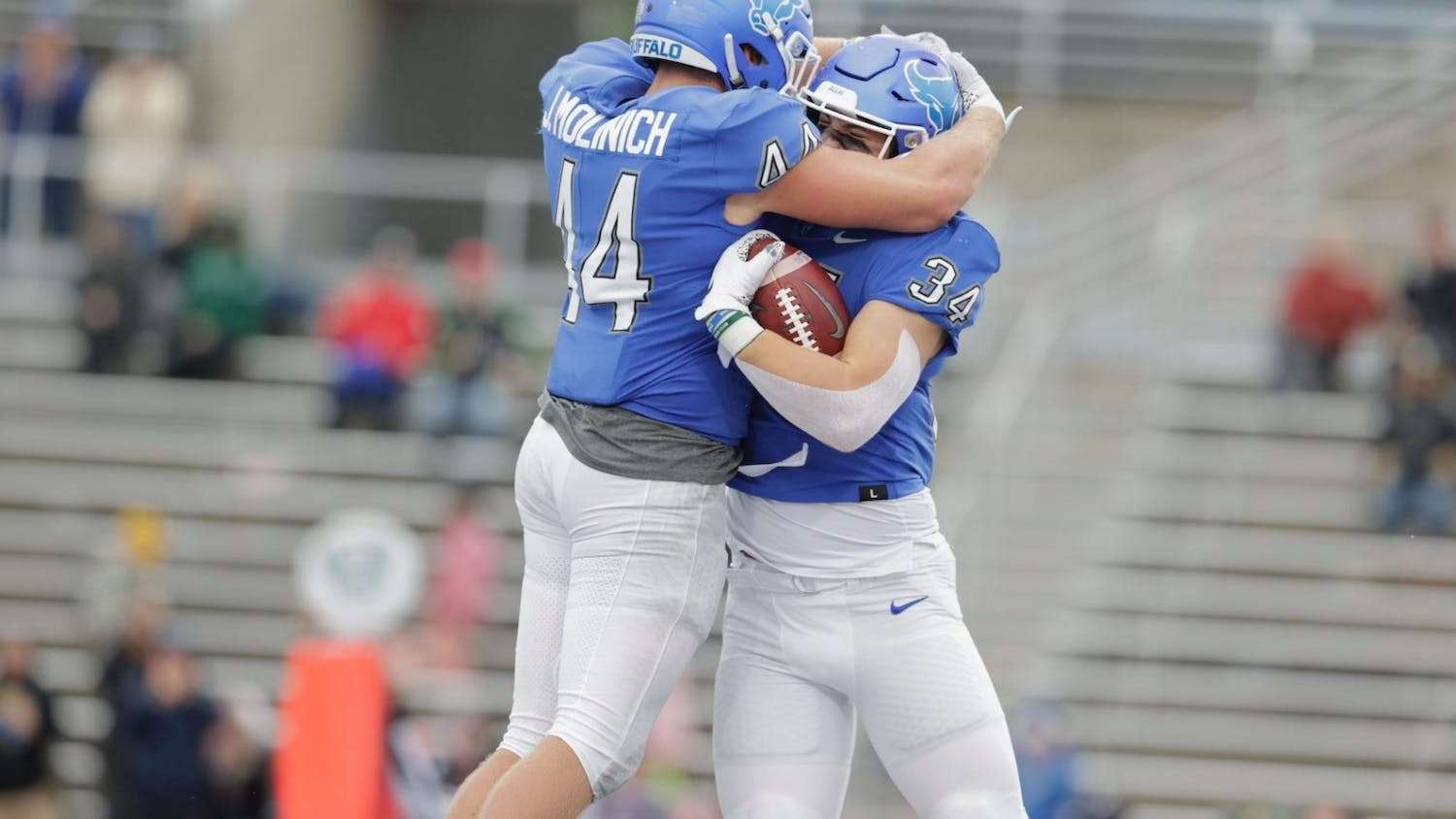 Sophomore tight end Trevor Borland (34) celebrates with redshirt fifth-year tight end Jake Molinich (44) following a touchdown Saturday.