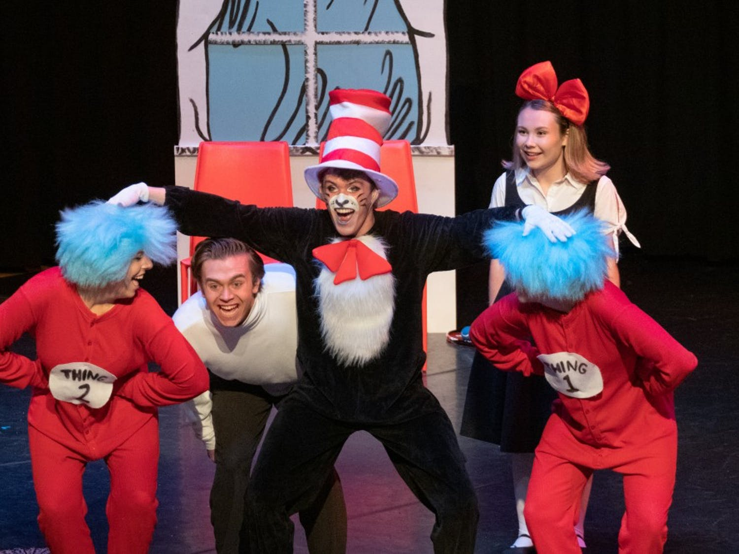 Dr. Seuss characters Sally, Conrad, Thing 1, Thing 2 and The Cat in the Hat on stage.