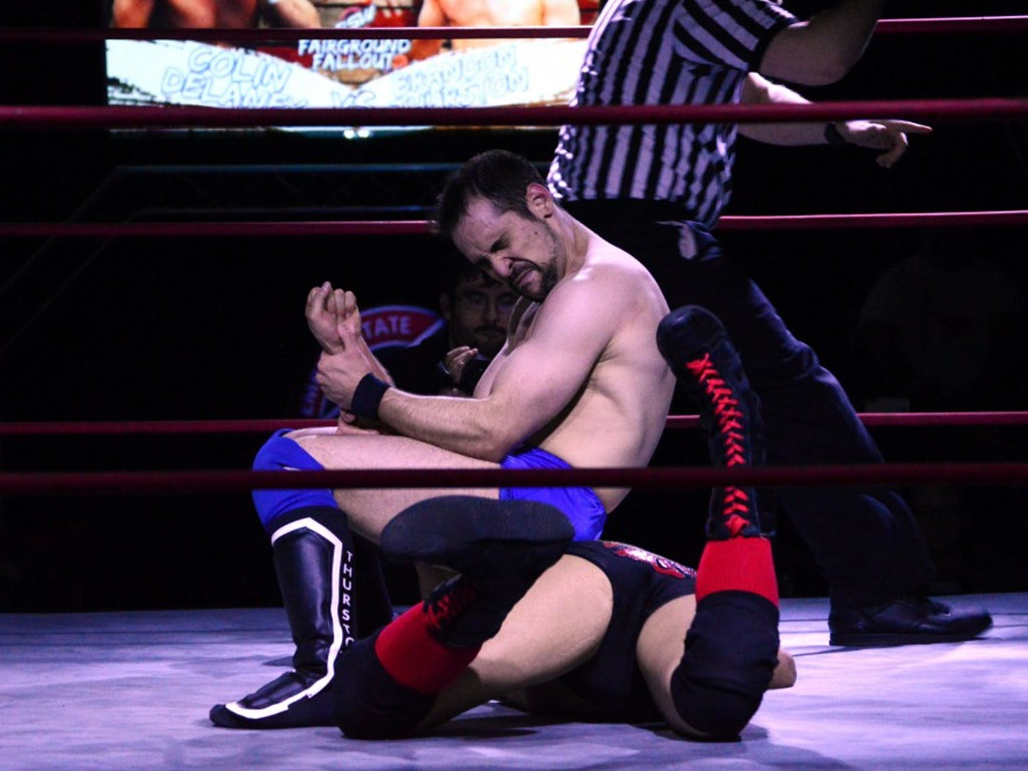 Brandon Thurston locks his opponent in an armbar. Thurston is a student of Japanese pro wrestling where performers strive to replicate reality and treat it as a serious sport.