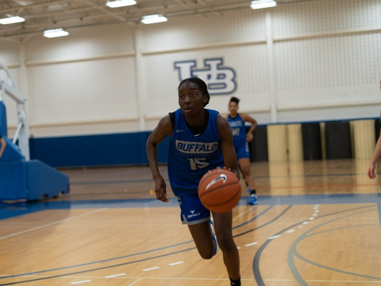 Sophomore Oceane Kounkou dribbling the ball during a practice session.
