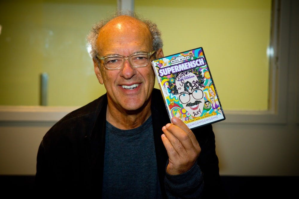<p>Retired music mogul Shep Gordon holds a copy of his documentary, which Mike Myers made about his life. Gordon often refers to his time at UB as some of the greatest years of his life.</p>