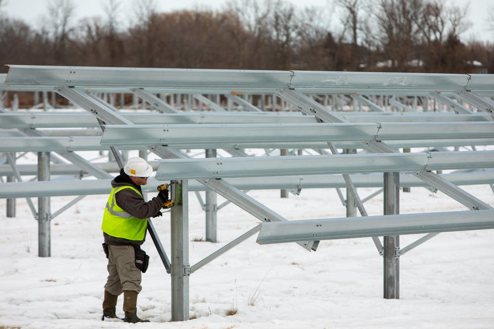 Workers installed a section of the Solar Stroll, located to the east of Millersport Highway, in February.