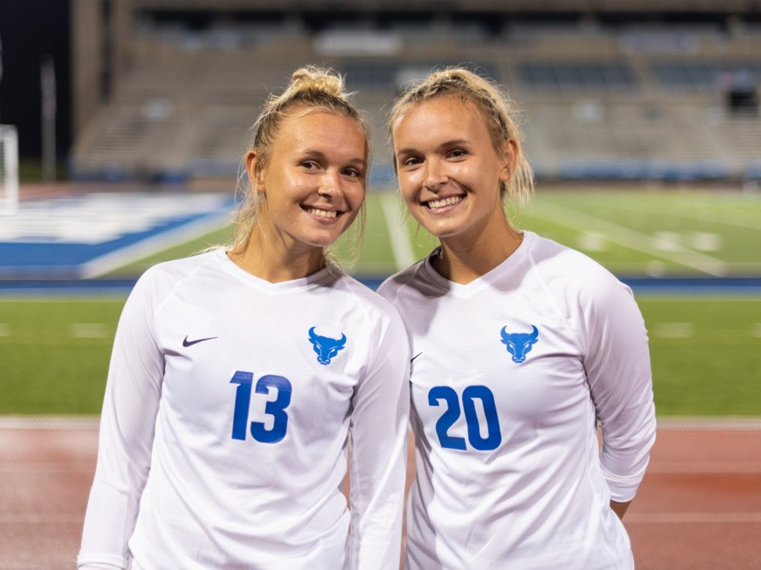 The Callaghan twins pose after a Sept. 6 victory against Houston Baptist at UB Stadium.