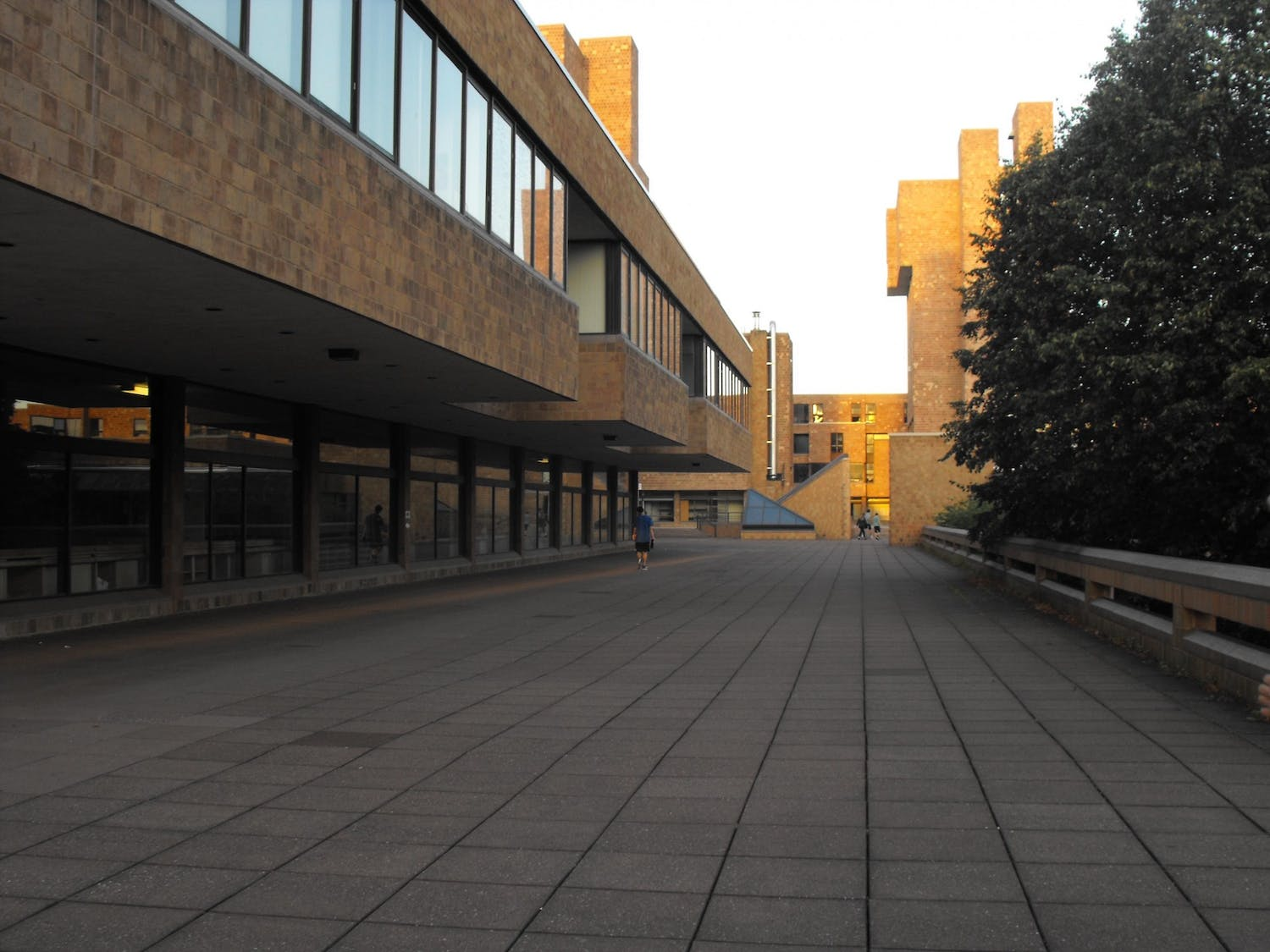 A student walks on the terrace of the Ellicott Complex.