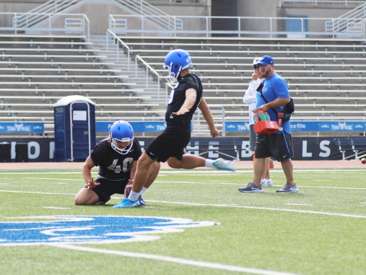 UB kicker Alex McNulty levels his foot against the ball at a summer football practice.